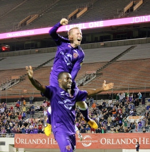 Photo Credit: Robert Van DeeringJean Alexandre celebrates with Jamie Watson after scoring what would be the game-winning goal for Orlando City.