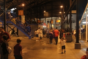 Photo Credit: Ty Wright Fans wait under the stands while rain drenches Fifth Third Field at the Citrus Bowl.